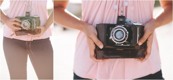 Woman holding vintage camera on beach