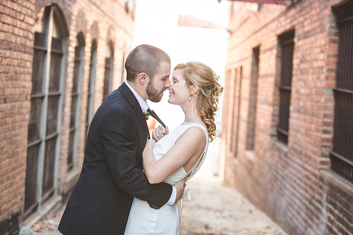 Bride and Groom kissing in alleyway